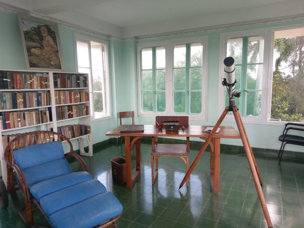 At the top of a three story tower, sits Ernest Hemingway's writing room. The tower sits beside his former home, a large in-ground pool, and his wooden boat.