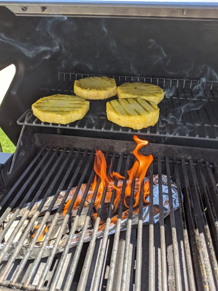 grilling pineapple over wood smoke for pineapple syrup