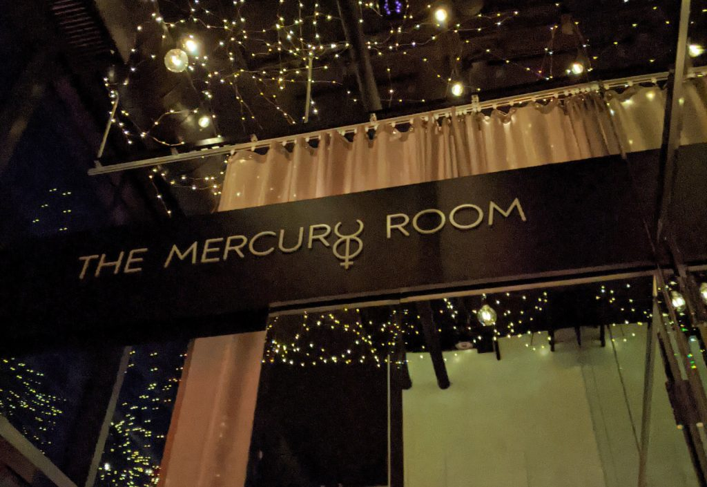 the mercury room sign and logo