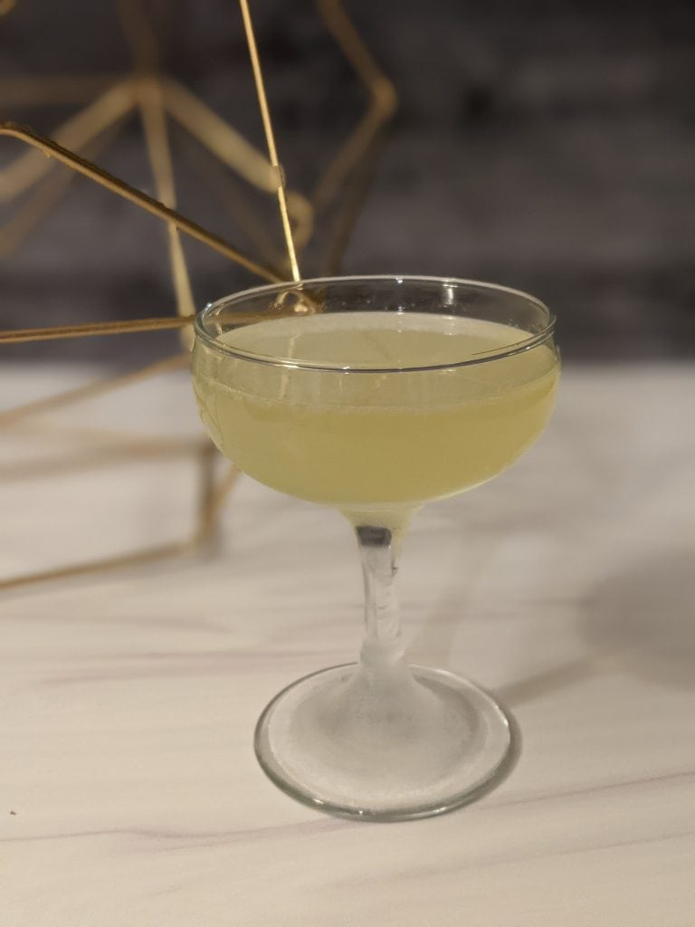 dutch word cocktail with bols genever in a coupe glass