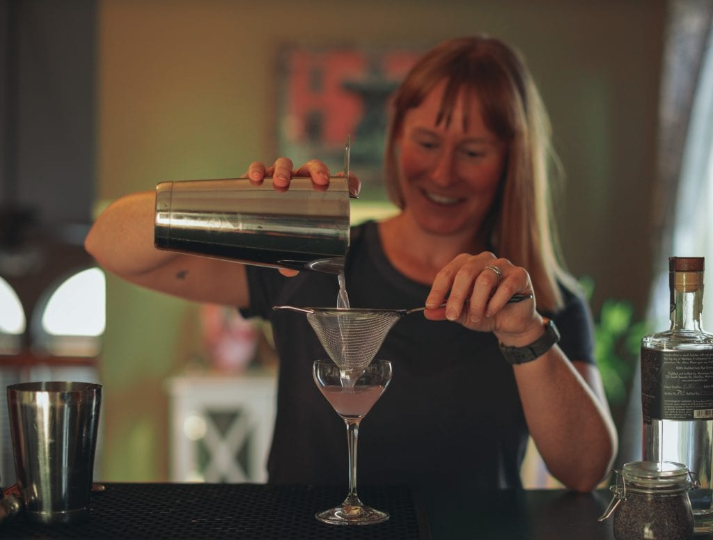 jenn pouring a vodka gimlet