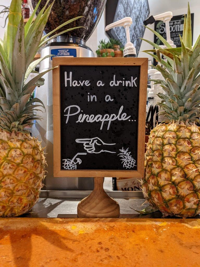 bars in oahu drinks in a pineapple