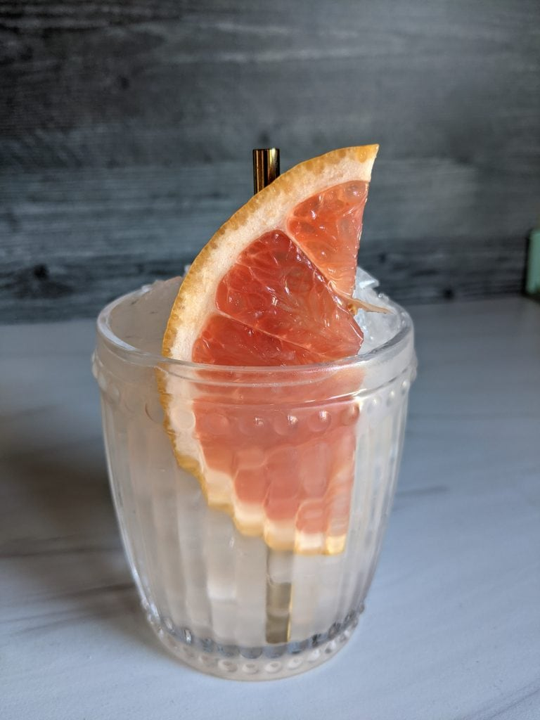 cocktails using lilac simple syrup paloma with grapefruit slice