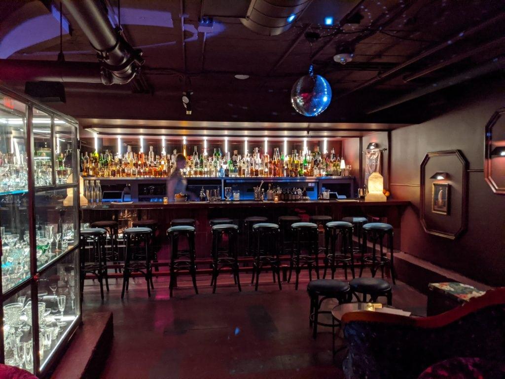 bars in portland oregon multnomah whiskey library shelves