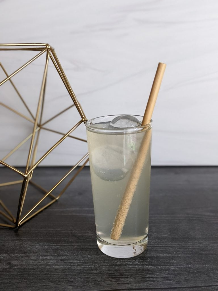 tepache cocktails highball with mezcal and bamboo straw