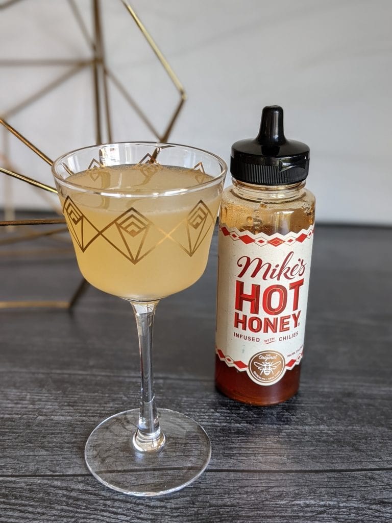 spicy gin cocktails bee sting with hot honey syrup