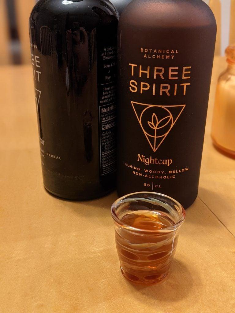nightcap three spirit drinks in a shot glass