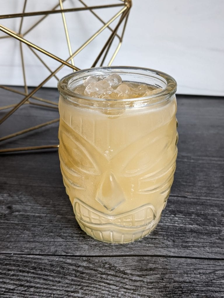apple juice and rum in a tiki drink
